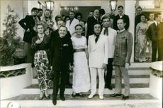 1st Earl Alexander of Tunis striking a pose with other people for a photograph.