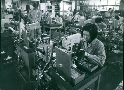 Work laborers working at the factory.