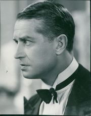 Young Maurice Chevalier looks furious.