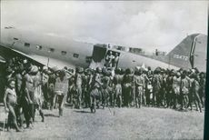 New Guinea islanders marvel at US Army transport.