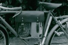 Goods packed in bag, attached in bicycle, in Vietnam