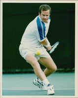 Tennis player John McEnroe in action