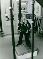 Woman standing and posing in the garment showroom.