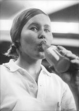 Tennis player Katarina Frendelius drinks a soda