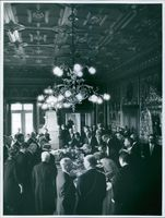 People having their meal together in a palace during an event.