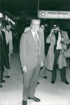 Richard Nixon is photographed on arrival in Paris