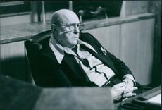 """A photo of Rod Steiger as Tony Vago sitting in the film """"Truth or Consequences, N.M."""". 1997."""