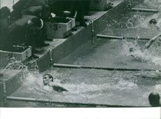 Athlete swimmers competing.