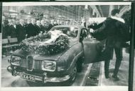 The first Finnish-built Saab car leaves the factory