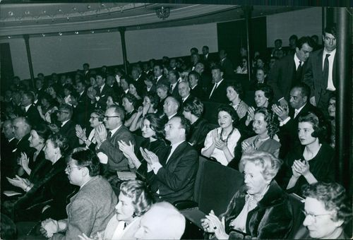 The audience applaud after the event. March 14, 1960