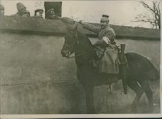 Man on the horse give cigarette to the soldiers during the war, Germany, 1915.