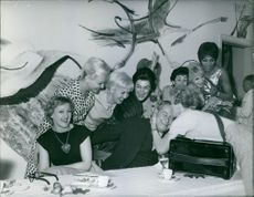 Some dancers from The Folies Bergère, pictured having fun together. 1961.