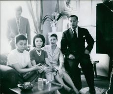 Members of The Lao Royal Family siting together.1961