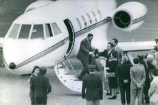 Former President of Argentina Juan Perón is going down from Plane by air-stair and being welcomed by some people