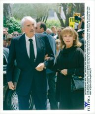 Portrait image of Gregory Peck and his wife Veronique taken at Frank Sinatra's funeral in Palm Springs.