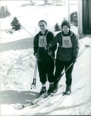 Two men enjoying skiing.  - 1965