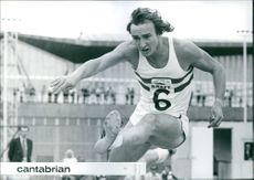 Alan Pascoe jumping on a hurdle.