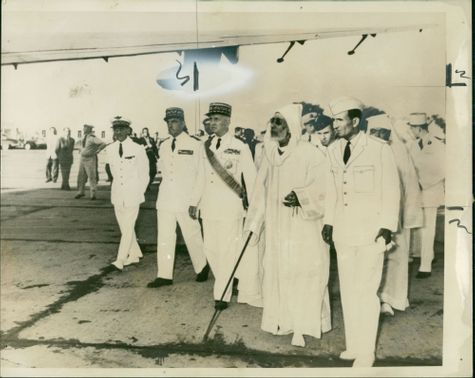 Gen de latour resident general in morocco walking with the sultan whom he saw off at the airport.