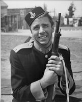 "Photography on actor Peter Lawford wearing full military equipment during the recording of the movie ""Rogue's March""."