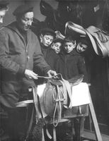 Man and children looking at strap.