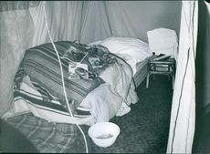 A photo of a room with magazine of katrina in the bed.