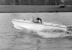 Princess Anne riding on a speedboat, 1960.