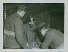 Soldiers siting while writing something during Tyskland war.