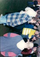 Insp Horace Bunton tries to keep a section of the crowd under control.