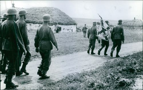 Soldiers marching in street.