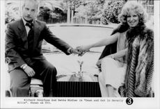 "Richard Dreyfuss and Bette Midler in the movie ""Down and Out in Beverly Hills"""