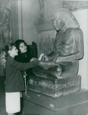 Girls looking at Egyptian statue, 1961.