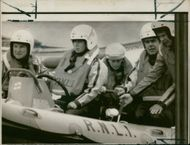 Princess Anne at the wheel of an RNLI lifeboat.