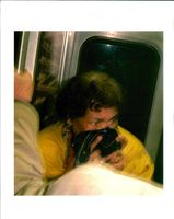 an undentified long island rail road passenger holds.