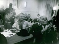 Gaston Defferre sitting while clapping his hands, 1964.