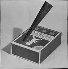 A spike police spike strips in size comparison with a matchstick box
