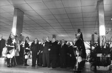 Charles de Gaulle standing with the officials, 1963.