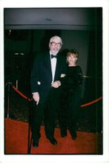 """Gregory Peck and his wife Veronique arrive at the """"Whitney Houston All Star Holiday Gala"""" at the Marriott Marrquis Hotel."""