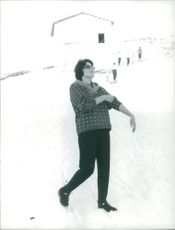 Silvana Mangano walking on snow.