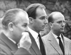 Prince Shah Karim Al Hussaini standing between two men. 1967