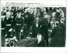 Mrs kennedy hold torch in John F. Kennedy funeral.