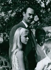 Jean, Grand Duke of Luxembourg smiling with his children both sides.