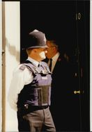 Armed police with bulletproof west guard at Downing Street