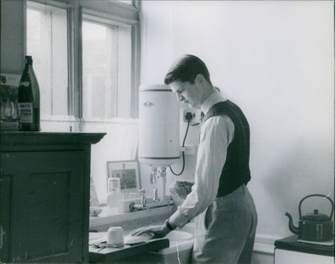 A young man in the kitchen.