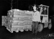Roland Johansson from Läkarmissionen on a forklift truck loaded with full milk milk bags to be sent to various hospitals in Leningrad