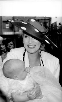 Portrait image of Jerry Hall with daughter Elizabeth Jagger, taken outside the church after the daughter's baptism.
