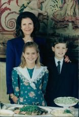 Queen Silvia together with Princess Madeleine and Prince Carl Philip