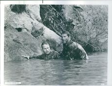 "A photo of two man in the water in a film ""The Deer Hunter"" 1978"