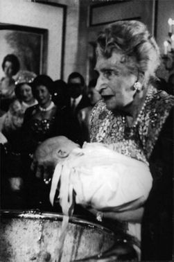 An old woman holding a baby in her arms.