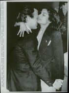 Maximilian Schell and Bianca Jagger dance on a gala