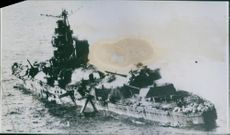 A Japanese cruiser destroyed and slowly sinking.